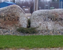 Two boulders inscribed with the words Kaizer Meadow
